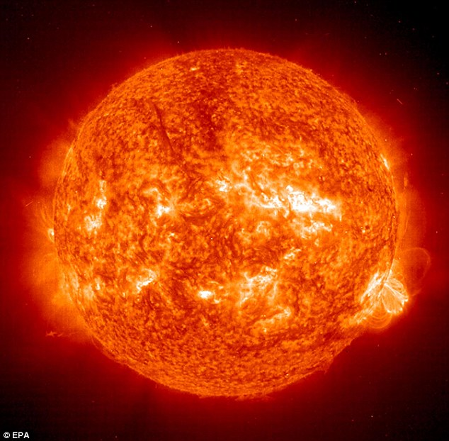 This 01 October, 2001 NASA Solar and Heliospheric Observatory (SOHO) EIT (Extreme ultraviolet Imaging Telescope) image of the Sun shows a solar flare leaping out from an active sunspot (lower-R). The largest solar explosions are classified as extraordinary, or X class, solar flares based on their X-ray emission.
