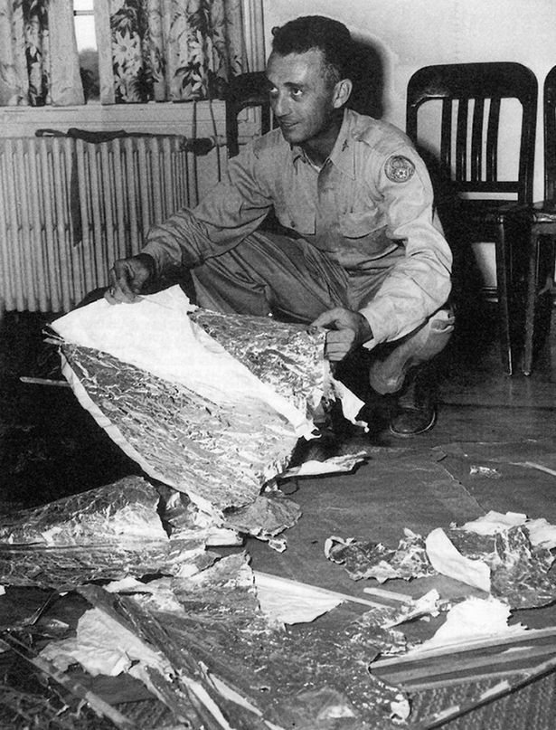 Major Jesse Marcel with debris found 75 miles north west of Roswell, NM, in June 1947