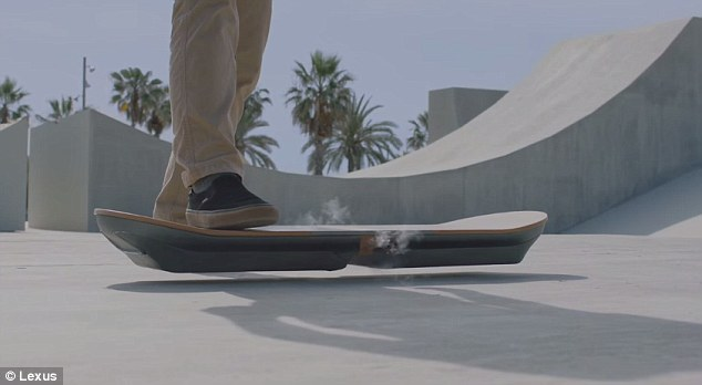 In the video a skater steps off their regular board and approaches the Slide hoverboard, which has smoke pouring out of its side. On a promotional site for the board, Lexus said it uses 'liquid nitrogen cooled superconductors and permanent mangets,' to levitate, which may account for the smoke