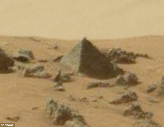 In their latest bizarre claim, conspiracy theorists say they have found a replica of one of Egypt's Great Pyramids on Mars. Citing the 'near-perfect design and shape', they say the pyramid could be evidence that an ancient civilisation once lived on the red planet