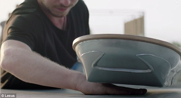 The new video stars Ross McGouran, a professional skateboarder, who says riding the Lexus Slide is 'like floating on air'. The board supposedly uses electromagnetism to levitate itself.