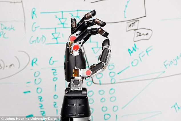 A robotic hand (pictured) that can restore the ability of patients to feel what it touches through a brain implant has been developed by scientists working with the US Defense Advanced Research Projects Agency