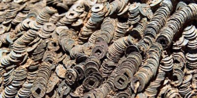 Ten Tonnes Of Ancient 2,000-Year-Old Copper Coins Unearthed From Ancient Grave