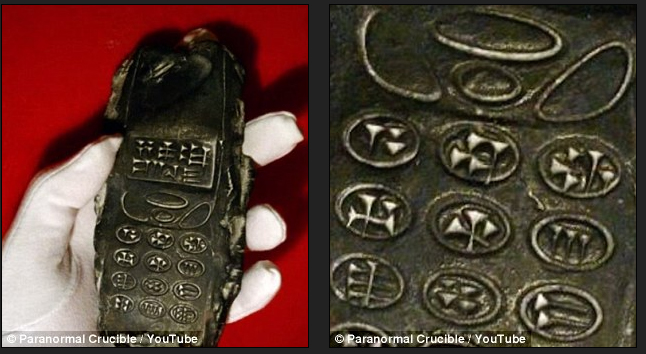 Bizarre claims that archaeologists have discovered an '800-year-old mobile phone' have sent conspiracy forums into overdrive. The object, allegedly found in Austria, is thought to be a clay model of a mobile phone with a cuneiform writing engraved on the keys