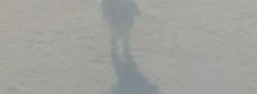 Mysterious shadowy figure that 'resembles the Iron Giant robot' filmed walking on clouds