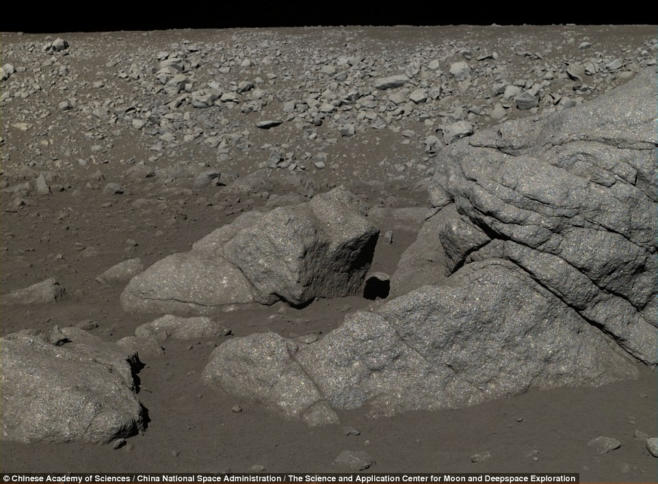 Along with the pebbles are larger boulders, caked in the same powdery rock dust which covers the lunar surface