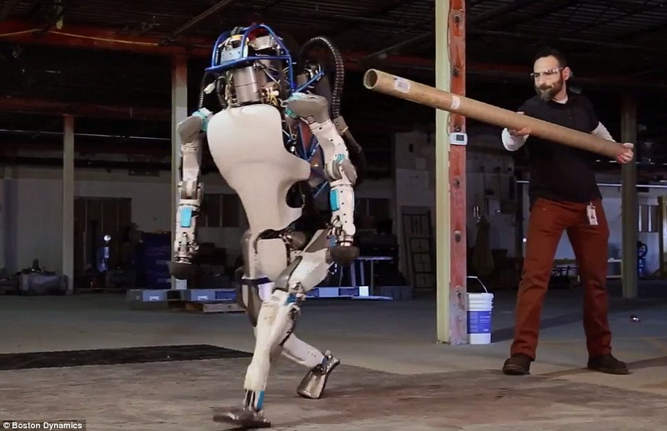 He's behind you! Boston Dynamic has revealed the new wireless version of its humanoid robot in a new video showing it walk, run, and even be pushed over and get up again on its own.