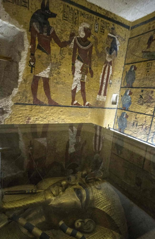 The golden sarcophagus of King Tutankhamun in his burial chamber at the Valley of the Kings. Radar scans of the tomb have revealed two previously undiscovered chambers, possibly containing organic material.
