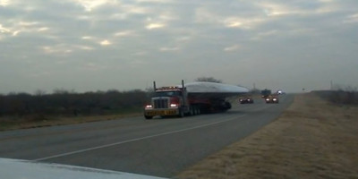 UFO Transported On A Flatbed Truck Escorted by US Agents