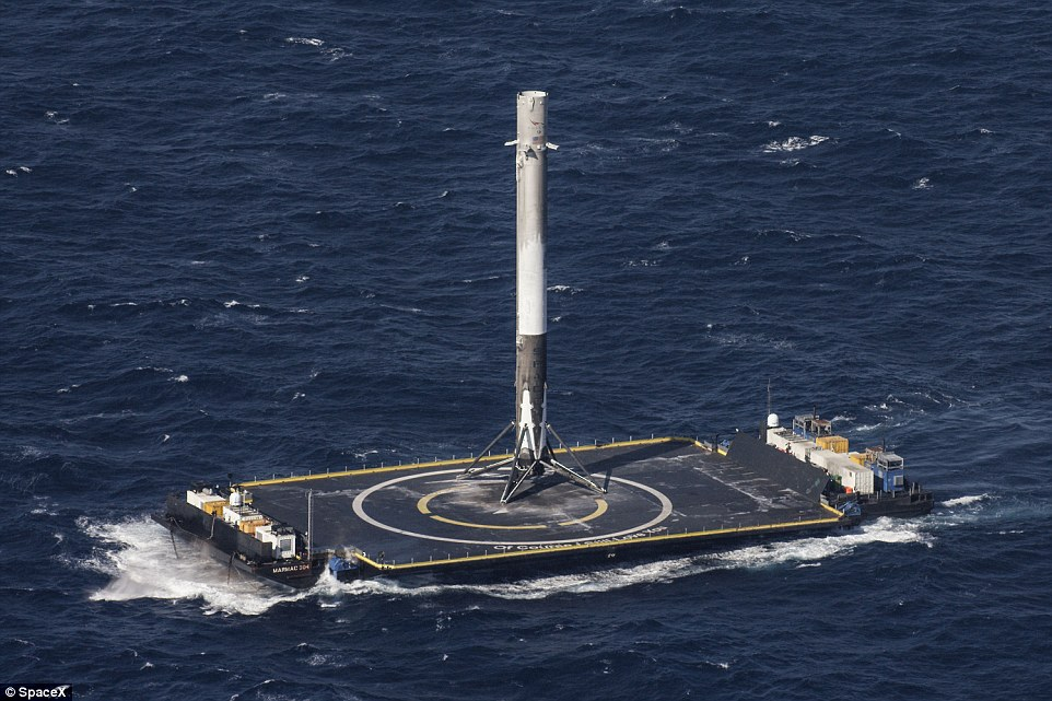 Images of the tall, narrow rocket gliding down onto a droneship sparked applause and screams of joy at SpaceX mission control on Friday