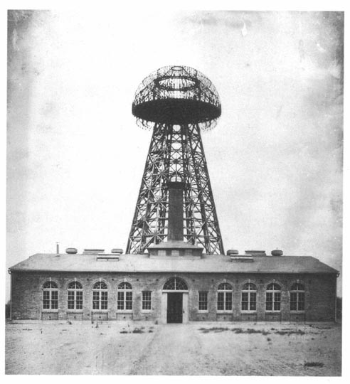 1904 image of Wardenclyffe Tower located in Shoreham, Long Island, New York. The 94 by 94 ft (29 m) brick building was designed by architect Stanford White.