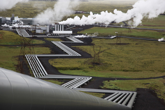 Giant ducts carry superheated steam from within a volcanic field to the turbines at Reykjavik Energy's Hellisheidi geothermal power plant in Iceland. Scientists have a found a quick but not cheap way to turn heat-trapping carbon dioxide into harmless rock.