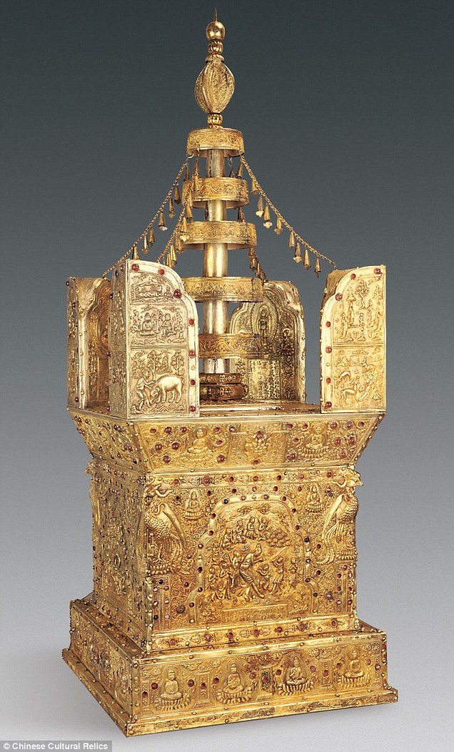 In a crypt underneath the Buddhist temple in Nanjing, locked safely in a stone chest, archaeologists found an ornate shrine called a stupa (pictured), used for meditation. The shrine is a box made from sandalwood, gold and silver with jewels embedded and contained the bone inside