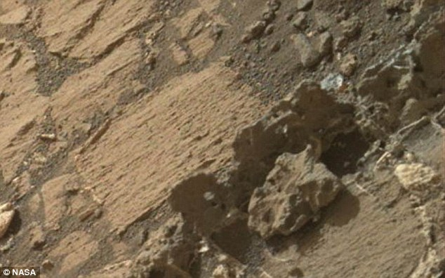 The YouTuber claims that the image shows Martian skeletal remains which bear 'undeniable' similarities to human bones, seen on the far right. And, the post argues that this was once likely a figure of great importance