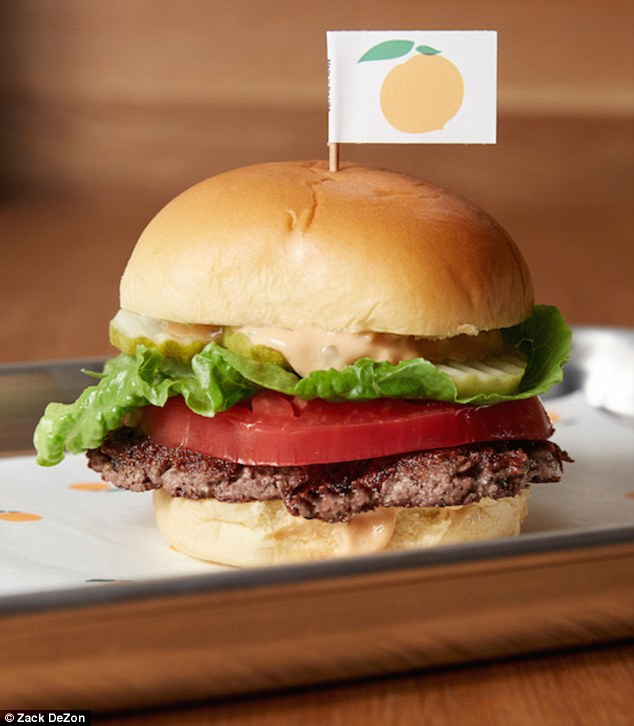 Trick: The Impossible Burger, pictured, is meat and cholesterol-free and claims to look, smell, sizzle and even taste like beef