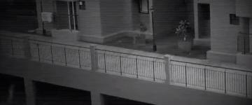 Apparition filmed by CCTV walking through building