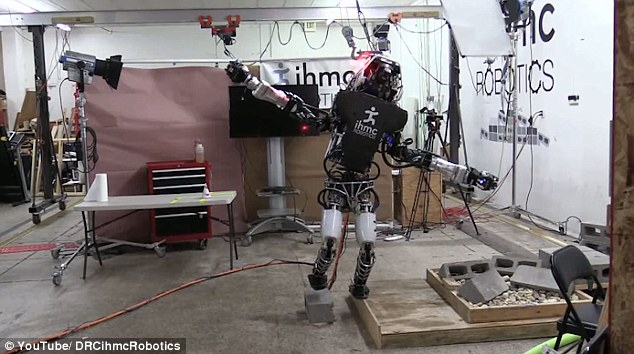 From throwing a paper aeroplane to doing a Karate Kid-style high kick, the list of tasks the Atlas robot can do is ever-growing. The latest movement mastered by the Boston Dynamics machine involves delicately balancing itself on a 0.7 inch-wide strip of plywood (shown)