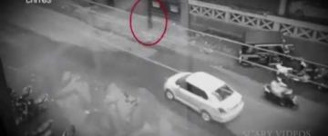 Shadow ghost filmed walking across busy road