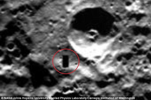Alien hunters have found what they claim to be an unexplained shadow on Mercury, which is caused by a large structure. The shadow is highlighted in red in the original Nasa image