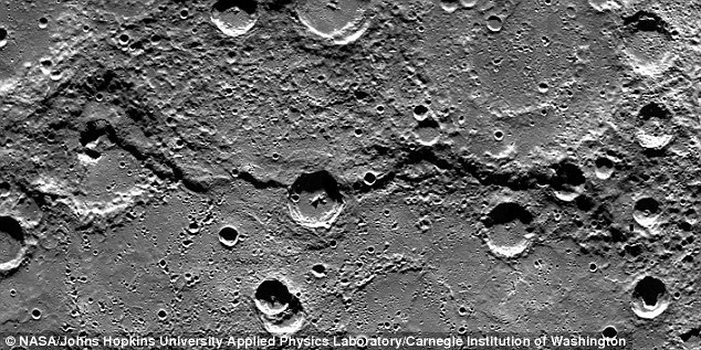 In the original Nasa image of Mercury's surface, captured by the Messenger probe, the crater left of centre is approximately 26 miles (42 kilometres) in diameter
