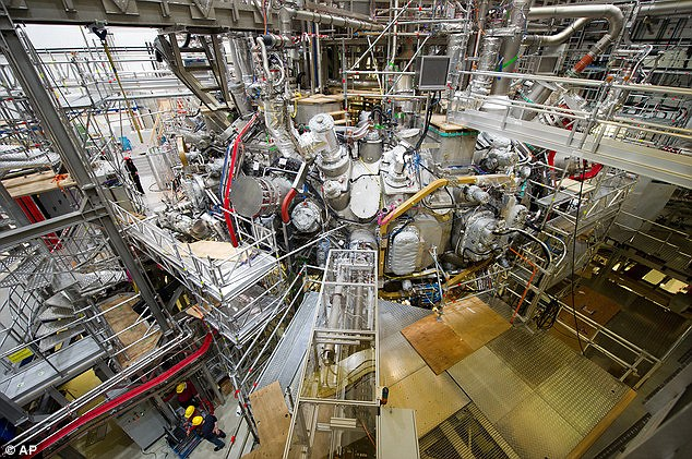 The nuclear fusion research centre at the Max Planck Institute for Plasma Physics is pictured. The device was first fired up in December using helium last year, which is easier to heat