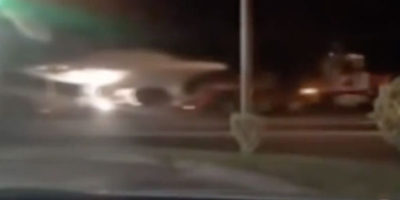 UFO on truck with police escort seen being driven at night