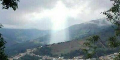 Giant Figure Of Light Appears Above City Wiped Out By Giant Landslide In Colombia