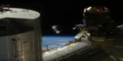 Strange UFO cylinder appears near the International Space Station