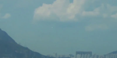 UFO Hovering over Airport in Hong Kong, China