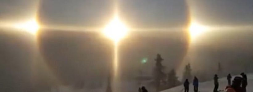 Skier captures a rare sun halo appear over mountains in Sweden
