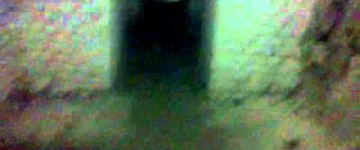 Dark Ghost Figure Seen on Abandoned Building