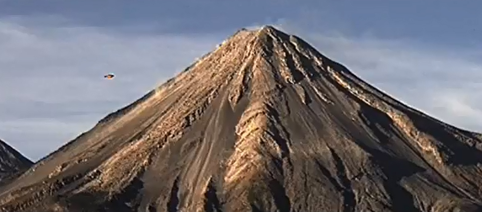Disk Shaped UFO filmed over Colima Volcano, Mexico – 26th March 2015