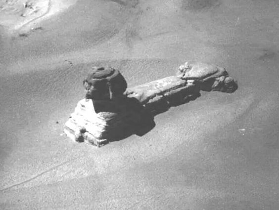 This is a rare image of the Sphinx taken from a hot air balloon, in the early 19th century. This is before excavation and restoration. Notice the HUGE 'hole' located on the head of the Sphinx.
