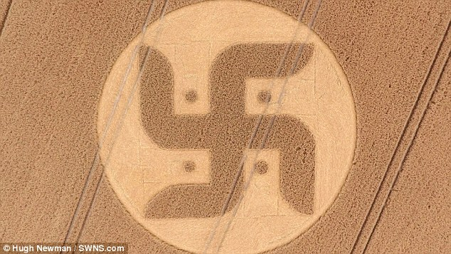 A huge crop circle in the shape of a swastika has been spotted in the Wiltshire countryside