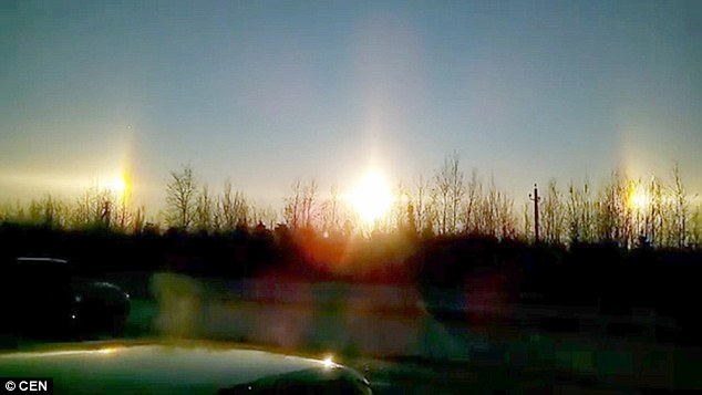 Incredible footage and images show three suns appearing in the sky over Russia. People in Russia's second city of St Petersburg were left stunned by the unusual sight. The triple sun scene was the result of a rare natural phenomenon