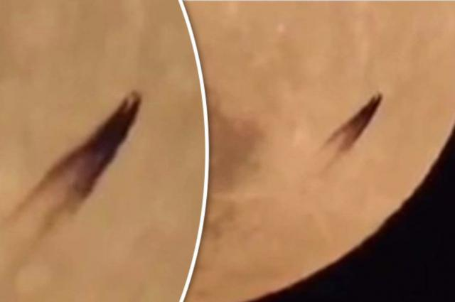 A mysterious UFO filmed traveling between the Earth and the Moon